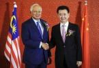 Prime Minister Datuk Seri Najib Razak with Dalian Wanda Group chairman Wang Jianlin during their meeting in Beijing today.