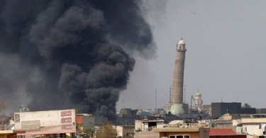 Smoke bellows near the leaning minaret of Grand al-Nuri Mosque which will be the centre of Islamic State's final stand in Mosul.