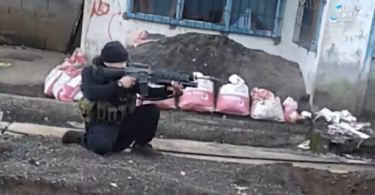 A militant taking aim at soldiers in the battle for Marawi