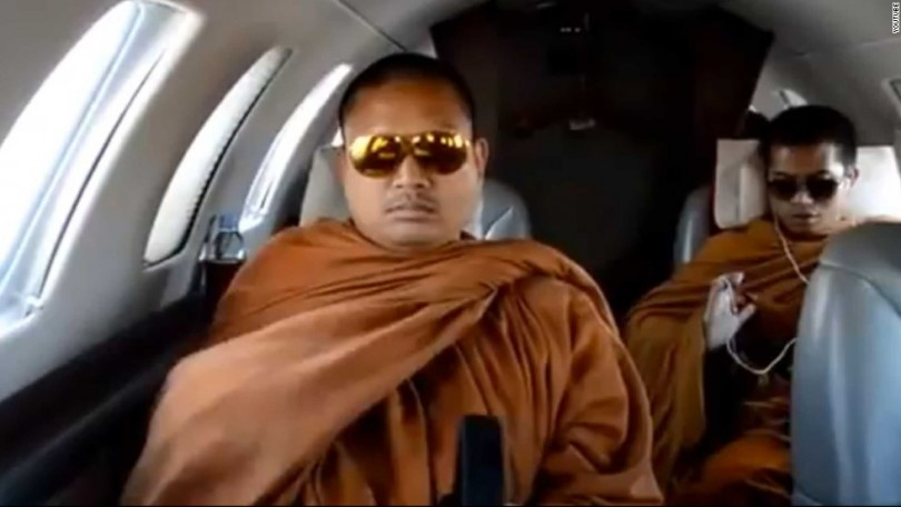 A photo grab from a YouTube video in 2013 showing Wirapol (left) flying in a private jet.
