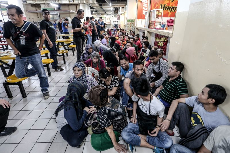 Foreign workers awaiting further checks by Malaysian Immigration.
