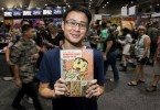 "Sonny Liew poses with his ""The Art of Charlie Chan Hock Chye"""