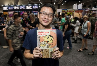 """Sonny Liew poses with his """"The Art of Charlie Chan Hock Chye"""""""