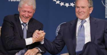 Former U.S. Presidents Bill Clinton (L) and George W. Bush