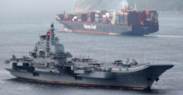 With its Soviet-era takeoff ramp distinguishing it from the ordinary Hong Kong traffic of container ships and bulk cargo vessels, the 55,000-tonne Liaoning steamed down the congested East Lamma channel shortly after dawn.