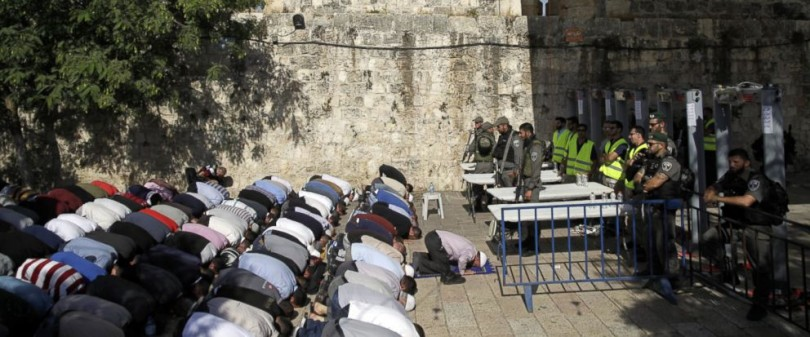 Palestinians performing Friday prayers in front of the metal detectors manned by Israeli soldiers rather than going through the device to pray at the Al-Aqsa mosque.
