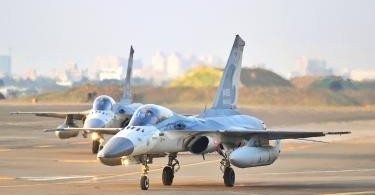 Taiwan's Indigenous Defense Fighter jets wait for the order to takeoff at Tainan Air Force Base .