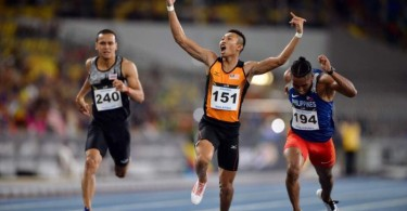 Khairul Hafiz Jantan celebrates after winning the 100m men's sprint