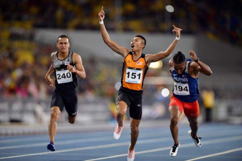 Khairul Hafiz Jantan celebrates after winning the 100m men's sprint