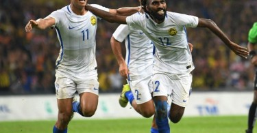 N.Thanabalan celebrates with his teammates after scoring Malaysia's winning goal against Indonesia.