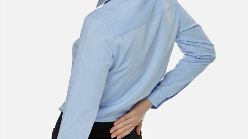 Businesswoman touching her lower back