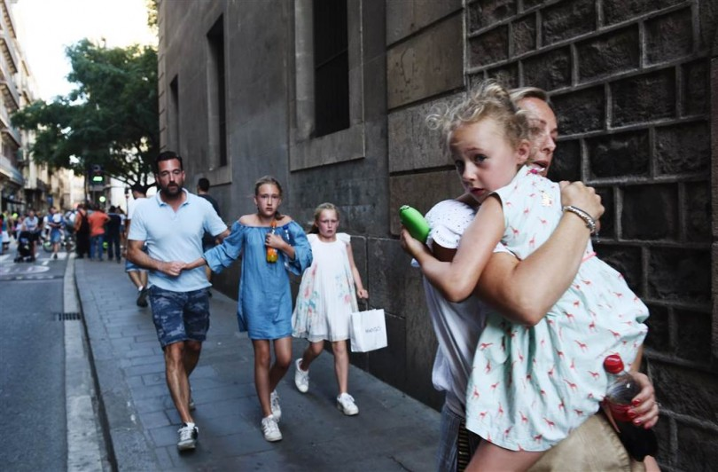Pedestrians fleeing during the terror attack in Barcelona yesterday.
