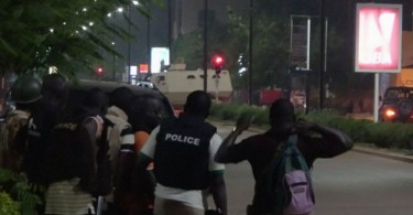 Police are seen on a street following an attack by gunmen on a restaurant in Ouagadougou, Burkina Faso, in this still frame taken from video