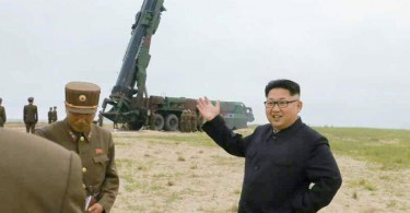 Kim Jong Un showing off one of his nuclear-capable ballistic missiles.