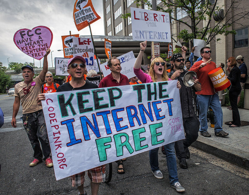 Protesters hold a rally before the FCC meeting on net neutrality proposal in Washington, DC.