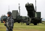 A Japan Self-Defense Forces (JSDF) soldier takes part in a drill to mobilise their Patriot Advanced Capability-3 (PAC-3) missile unit in response to a recent missile launch by North Korea, at U.S. Air Force Yokota Air Base in Fussa on the outskirts of Tokyo,