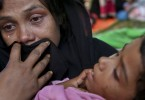 A Rohingya woman cries after being stopped by Bangladeshi border guards at a makeshift shelter at Ghumdhum, Cox's Bazar, Bangladesh.