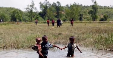 Rohingya children make their way through water as they try to come to the Bangladesh side of the border. Several of them were hurt by explosions, believed to be that of landmines over the past few days.