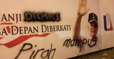 A defaced billboard bearing Prime Minister Datuk Seri Najib Razak's image.