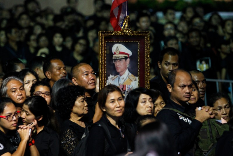 Mourners queue as they attend the Royal Cremation ceremony of Thailand's late King Bhumibol Adulyadej near the Grand Palace in Bangkok