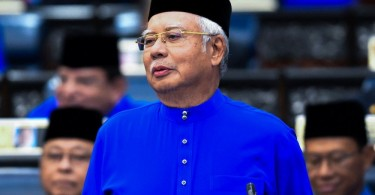 Prime Minister/Finance Minister Datuk Seri Najib Razak tabling the 2018 budget.