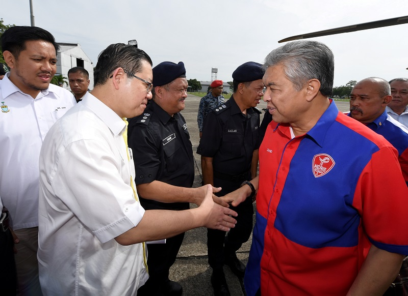 Deputy Prime Minister Datuk Seri Ahmad Zahid Hamidi is greeted by Penang Chief Minister Lim Guan upon his arrival in flood hit-Penang today.