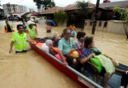 Rescuers evacuating residents of Jalan P. Ramlee in Penang yesterday.