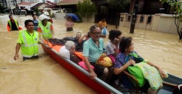 Rescuers evacuating residents of Jalan P. Ramlee in Penang yesterday.