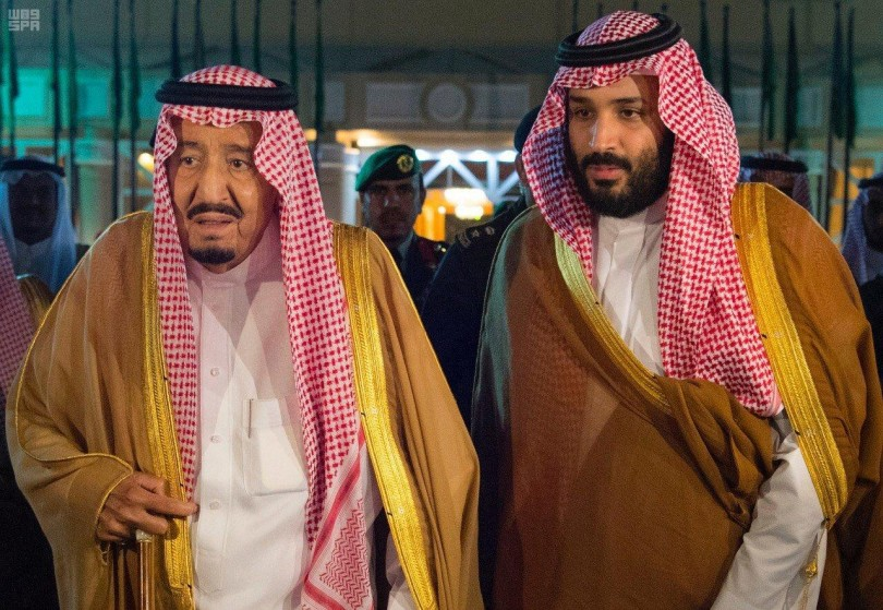 Saudi Arabia's King Salman bin Abdulaziz Al Saud walks with his son and Crown Prince Mohammed bin Salman, before King Salman leaves for Medina from Riyadh on Wednesday.