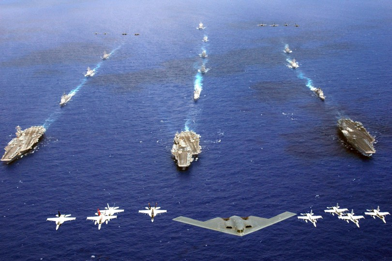 A B-2 Spirit and 16 other aircrafts  fly over vessels of US carrier strike groups in the western Pacific Ocean during Exercise Valiant Shield in June 2006.