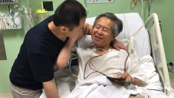 Alberto Fujimori celebrates his pardon with son Kenji.