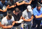 Nidal Aboud, a Christian, holds a Bible and prays beside Muslims in Jerusalem, during a protest against Israeli's restrictions at the Al-Aqsa Mosque in July.