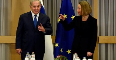 EU foreign policy chief Federica Mogherini gestures at Israeli Prime Minister Benjamin Netanyahu at the European Council headquarters in Brussels