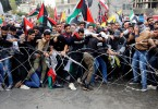 Protesters trying to remove barbed wire blocking a road leading to the United States Embassy, east of Beirut, Lebanon, yesterday.
