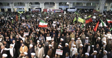 Protesters chant slogans at a rally in Tehran yesterday.