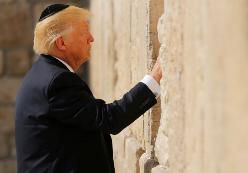 US President Donald Trump places a note in the stones of the Western Wall, Judaism's holiest prayer site, in Jerusalem's Old City on May 22 2017