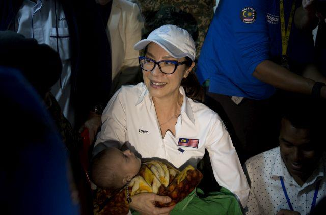 Michelle Yeoh, holds a Rohingya refugee child during her visit to the Malaysia field hospital at Kutupalong refugee camp near Cox's Bazar, Bangladesh,