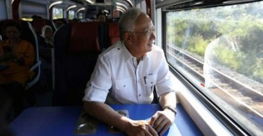 Prime Minister Datuk Seri Najib Razak onboard the ETS (Electric Train Service) on his way to Tanjung Malim. Najib said Tanjung Malim will receive the spillover by undergoing drastic changes in the next five to six years.