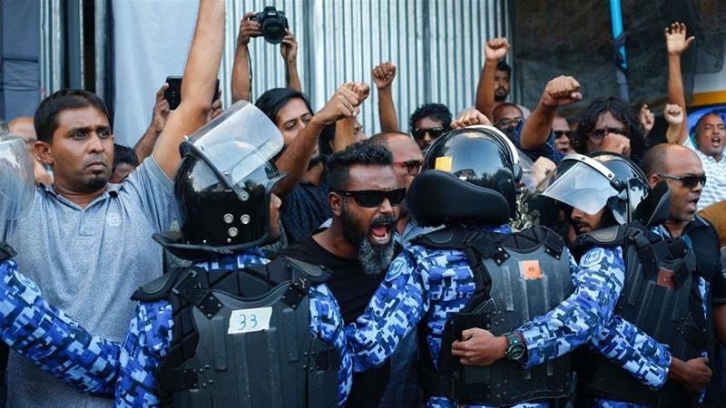 Protesttors in Male face off with security forces.
