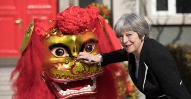 Theresa May  basking in a warm reception in China while concerned Chinese citizens affectionately nicknamed her 'Aunty May' and worried if her legs were warm enough in the Beijing cold.