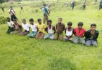 Ten Rohingya Muslim men with their hands bound kneel in Inn Din village just before they were killed on September 1, 2017