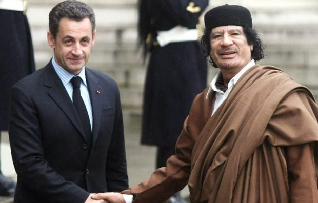 Sarkozy (left) and the late Libyan strongman in Paris in 2007.
