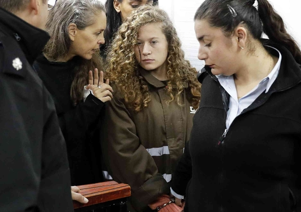 Ahed Tamimi listens to her Israeli lawyer Gaby Lasky at the military court.