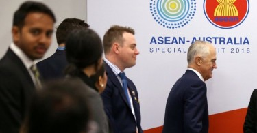 Australian Prime Minister Malcolm Turnbull walks past delegates as he arrives for an Emerging Leaders roundtable during the one-off summit of 10-member Association of Southeast Asian Nations (Asean) in Sydney today.