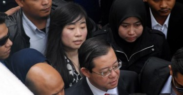 Penang Chief Minister Lim Guan Eng(in red tie) and businesswoman Phang Li Koon(behind Guan Eng)
