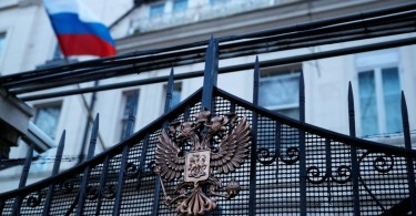 Russia's flag flies from the consular section of its embassy, in central London