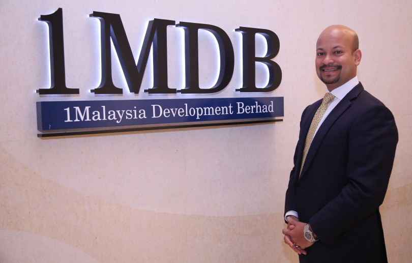 Arul Kanda Photo with 1MDB Logo.JPG