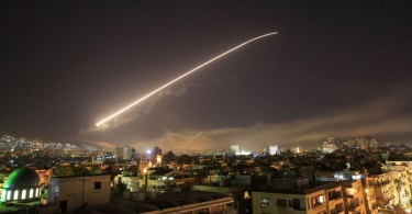 The Damascus sky lights up with surface-to-air missile fire during the air strikes.