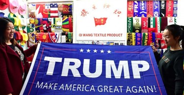 Two women running business of banners pose with a support banner for Republican presidential candidate Donald Trump at Yiwu International Trade Centre on November 10, 2016 in Jinhua, Zhejiang Province of China.