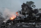 141117124827-mh17-wreckage-flames-smoke-exlarge-169
